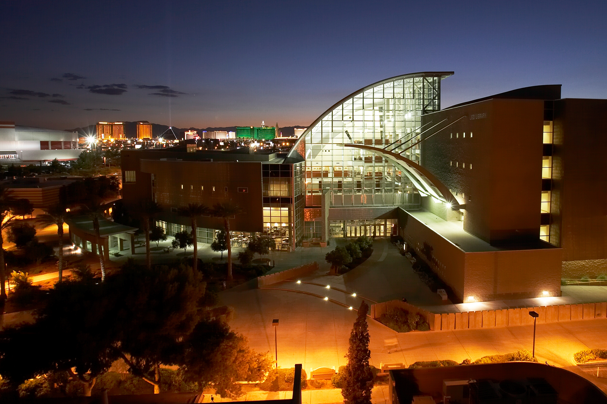 Night time shot of Lied Library, with Las Vegas Strip in background.